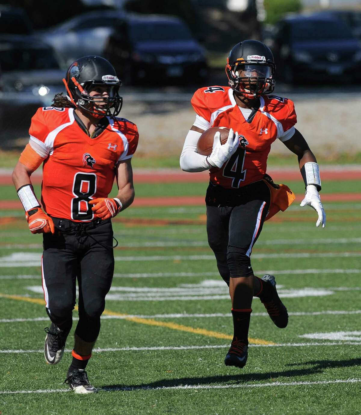 Stamford's Guyeens Antoine carries the ball during Saturday's game at Stamford High School on September 27, 2014.