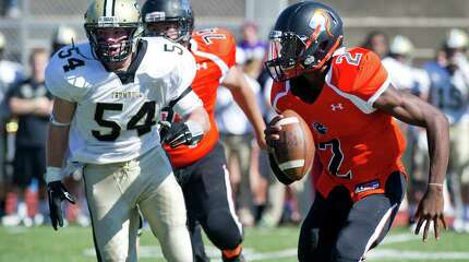 Stamford's Jalen Brown carries the ball during Saturday's game at Stamford High School on September 27, 2014.