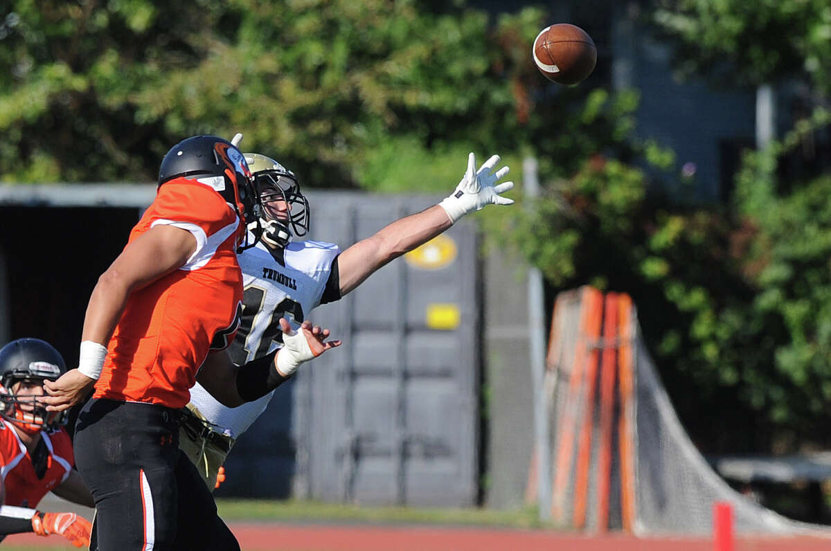 Trumbull's Niko Prinicpi reaches for a pass that fell incomplete during Saturday's game at Stamford High School on September 27, 2014.