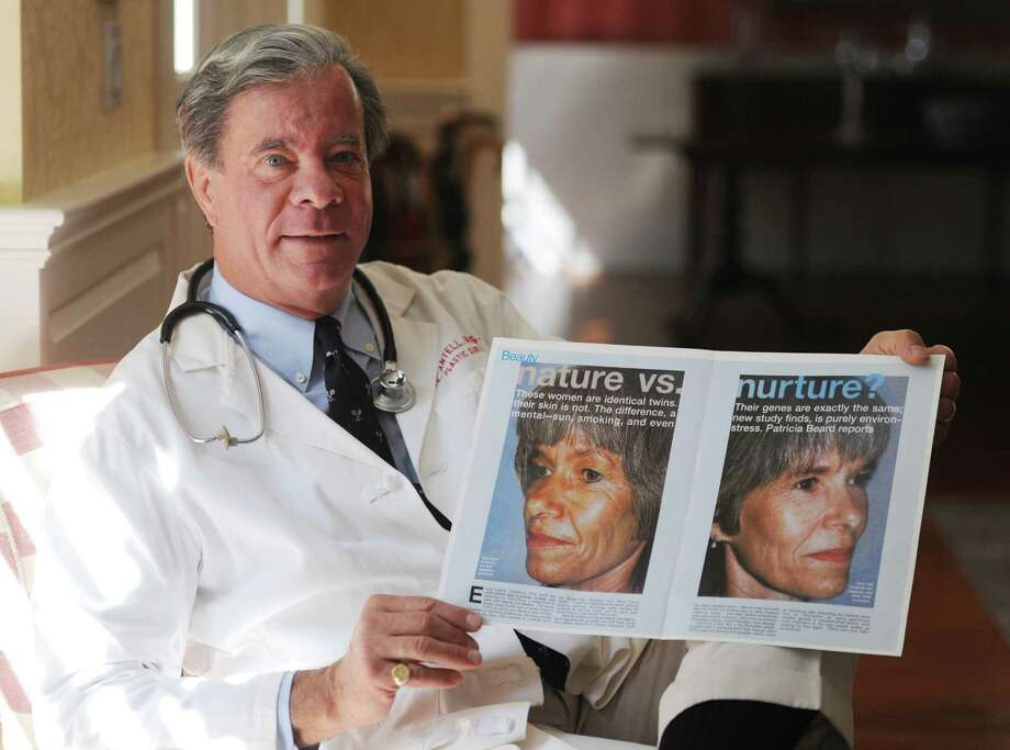 Plastic Surgeon Darrick Antell, M.D. holds an article showing his work published in Elle magazine inside his home in Greenwich, Conn. Saturday, Sept. 27, 2014.  Dr. Antell's nature versus nurture study of identical twins was recently featured at the Smithsonian Museum of Natural History in Washington and will go on the road to be shown at several other cities throughout the country. Photo: Tyler Sizemore / The News-Times