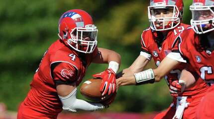 Photos from New Canaan's 35-20 win over Greenwich in the high school football game at New Canaan High School in New Canaan, Conn. Saturday, Sept. 27, 2014.