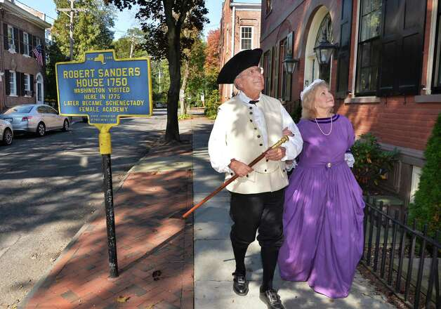 Stockade residents and reenactors George and Patricia Marshall walk past the Sanders house on Washington Avenue during the 2014 Stockade Walkabout Saturday Sept. 27, 2014, in Schenectady, NY.  (John Carl D'Annibale / Times Union) Photo: John Carl D'Annibale / 10028795A