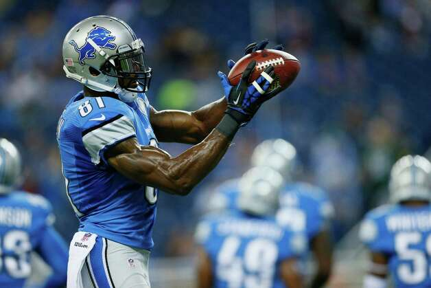 Detroit Lions wide receiver Calvin Johnson makes a catch during warm-ups before an NFL football game against Green Bay in Detroit, Sunday, Sept. 21, 2014. (AP Photo/Rick Osentoski) ORG XMIT: DTF101 Photo: Rick Osentoski / FR170444 AP