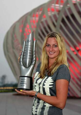 Petra Kvitova of the Czech Republic poses with the trophy outside the center court stadium after she defeated Eugenie Bouchard of Canada in the final of the Wuhan Open tennis tournament in Wuhan, in China's Hubei province Saturday, Sept. 27, 2014. (AP Photo) CHINA OUT ORG XMIT: XAW805 / CHINATOPIX