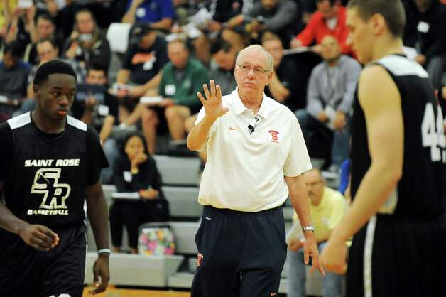 Syracuse coach Jim Boeheim, center, works with players Micael-Ryan Boyd, left, and Sam Eckstrom as he speaks during a coaching clinic on Saturday, Sept. 27, 2014, at The College of Saint Rose in Albany, N.Y. (Cindy Schultz / Times Union) Photo: Cindy Schultz / 00028750A