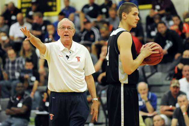 Syracuse coach Jim Boeheim, left, works with player Sam Eckstrom as he speaks during a basketball coaching clinic on Saturday, Sept. 27, 2014, at The College of Saint Rose in Albany, N.Y. (Cindy Schultz / Times Union) Photo: Cindy Schultz / 00028750A