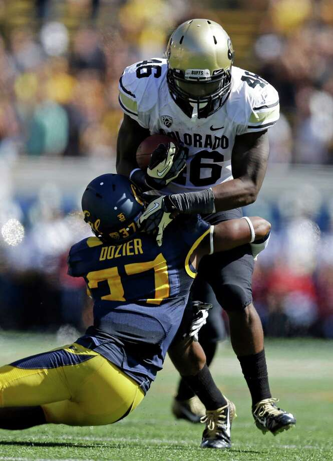 Colorado's Christian Powell (46) is tackled by California's Cedric Dozier (37) during the first half of an NCAA college football game Saturday, Sept. 27, 2014, in Berkeley, Calif. (AP Photo/Ben Margot) Photo: Ben Margot / Associated Press / AP