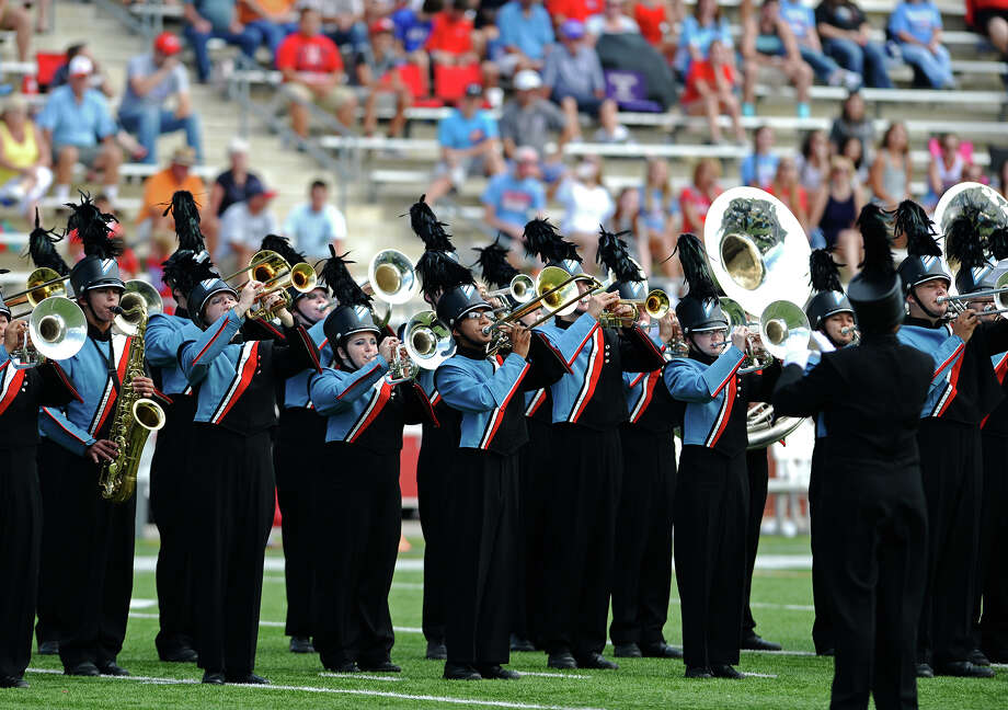 "The Lumberton High School band performs during halftime of Saturday's game against Ozen. The Ozen Panthers played against the Lumberton Raiders at the Carrol A ""Butch"" Thomas Educational Support Center on Saturday.  Photo taken Saturday 9/27/14  Jake Daniels/@JakeD_in_SETX Photo: Jake Daniels / ©2014 The Beaumont Enterprise/Jake Daniels"