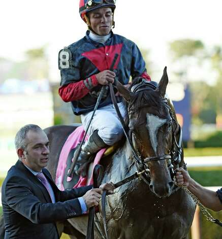 Tonalist with jockey Joel Rosario heads for the winner's circle after putting away the field of 11 contestants to win the 96th running of The Jockey Club Gold Cup Saturday evening Sept. 27, 2014, at Belmont Park in Elmont, N.Y.    (Skip Dickstein/Times Union) Photo: SKIP DICKSTEIN