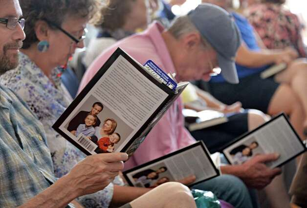 An eager audience reads from U.S. Senator Kirsten Gillibrand's book as they await her appearance at a NYS Writer's Institute Visiting Authors series at UAlbany Saturday Sept. 27, 2014, in Albany, NY.  (John Carl D'Annibale / Times Union) Photo: John Carl D'Annibale / 10028796A