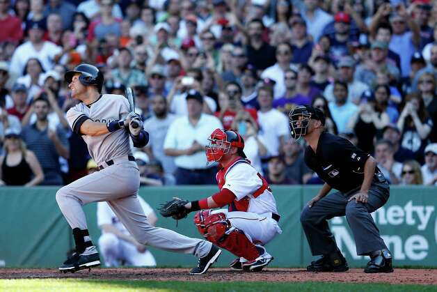 BOSTON, MA - SEPTEMBER 27:  Derek Jeter #2 of the New York Yankees hits a single in the third inning against the Boston Red Sox during a game at Fenway Park on September 27, 2014 in Boston, Massachusetts.  (Photo by Jim Rogash/Getty Images) ORG XMIT: 477590689 Photo: Jim Rogash / 2014 Getty Images