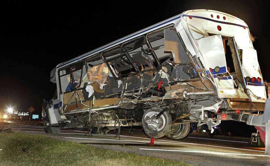 A wrecker moves the North Central Texas College women's softball team bus as Oklahoma officials investigate the fatal accident south of the Turner Falls area. Photo: Steve Sisney / Associated Press / THE OKLAHOMAN