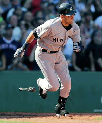 New York Yankees designated hitter Derek Jeter legs out a single against the Boston Red Sox during the third inning of a baseball game at Fenway Park in Boston, Saturday, Sept. 27, 2014. (AP Photo/Charles Krupa) ORG XMIT: MACK115 Photo: Charles Krupa / AP