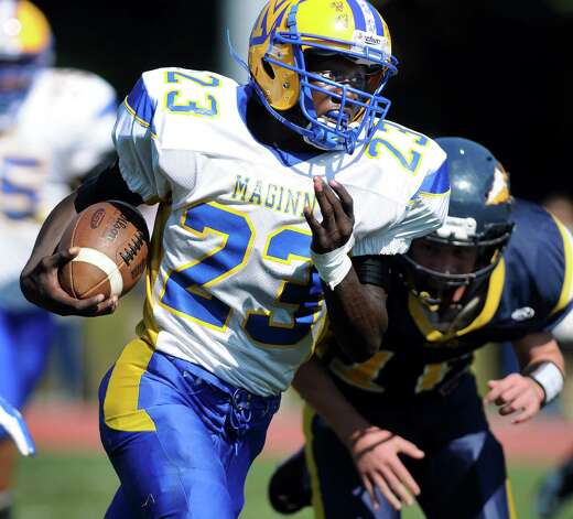 Bishop Maginn's Ky'Ere Tillery, center, gains yards during their football game against Averill Park on Saturday, Sept. 27, 2014, at Averill Park High in Averill Park, N.Y. (Cindy Schultz / Times Union) Photo: Cindy Schultz / 00028729A
