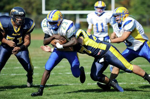 Bishop Maginn's Ky'Ere Tillery, center, runs for a touchdown as Averill Park's Ryan Garret defends during their football game on Saturday, Sept. 27, 2014, at Averill Park High in Averill Park, N.Y. (Cindy Schultz / Times Union) Photo: Cindy Schultz / 00028729A