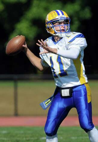 Bishop Maginn's quarterback Neiko Bianchino looks to pass during their football game against Averill Park on Saturday, Sept. 27, 2014, at Averill Park High in Averill Park, N.Y. (Cindy Schultz / Times Union) Photo: Cindy Schultz / 00028729A