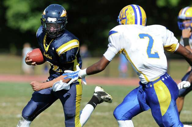 Averill Park's Brandon Cellucci, left, carries the ball as Bishop Maginn's Ayinde Duckett defends during their football game on Saturday, Sept. 27, 2014, at Averill Park High in Averill Park, N.Y. (Cindy Schultz / Times Union) Photo: Cindy Schultz / 00028729A