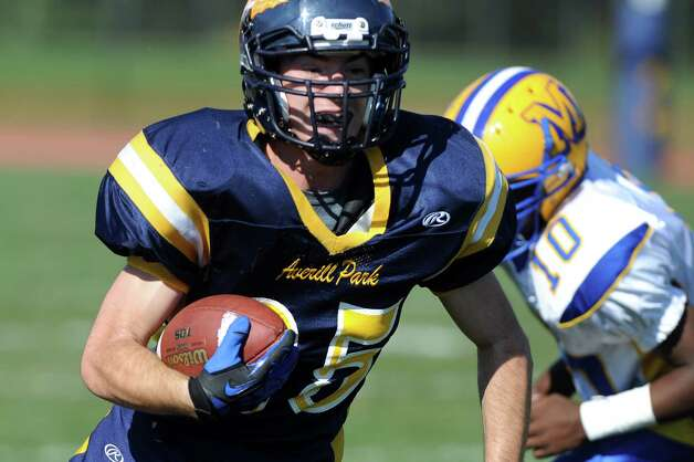 Averill Park's Joe Lettko, left, carries the ball during their football game against Bishop Maginn on Saturday, Sept. 27, 2014, at Averill Park High in Averill Park, N.Y. (Cindy Schultz / Times Union) Photo: Cindy Schultz / 00028729A