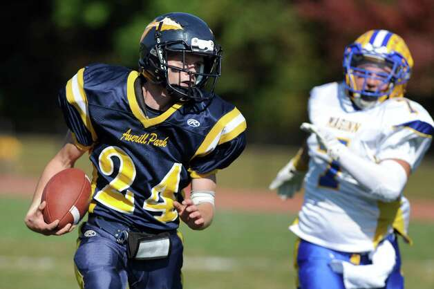 Averill Park's Nick Haase, left, carries the ball during their football game against Bishop Maginn on Saturday, Sept. 27, 2014, at Averill Park High in Averill Park, N.Y. (Cindy Schultz / Times Union) Photo: Cindy Schultz / 00028729A