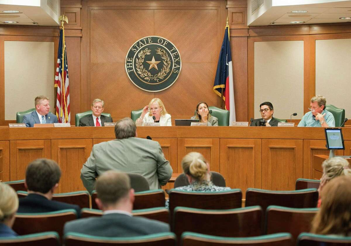 Dr. Craig Pearson, center, seismologist for the Texas Railroad Commission, speaks during a meeting by the state House Energy Subcommittee on Seismic Activity at the Texas state capitol on Mon.Aug. 24, 2014. Ashley Landis / For the Chronicle
