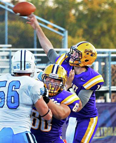 UAlbany's QB Will Fiacchi completes a pass to Brad Harris  for a touchdown as teammate #60 Domenic Fragola blocks Columbia's #56 Ray Pesanello during Saturday's game at Bob Ford Field in Albany, NY.  (John Carl D'Annibale / Times Union) Photo: John Carl D'Annibale / 00028710A