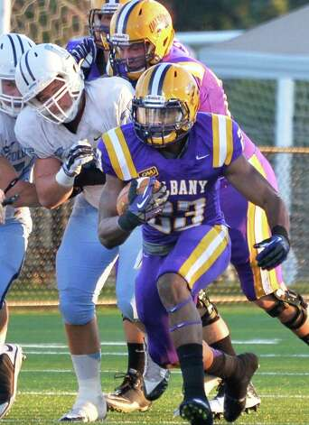 UAlbany's #23 Omar Osbourne carries for yardage during Saturday's game against  Columbia at Bob Ford Field in Albany, NY.  (John Carl D'Annibale / Times Union) Photo: John Carl D'Annibale / 00028710A