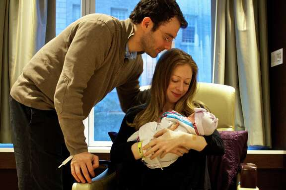 Chelsea Clinton and husband Marc Mezvinsky admire their daughter, Charlotte Clinton Mezvinsky, on Saturday at Lenox Hill Hospital in New York.