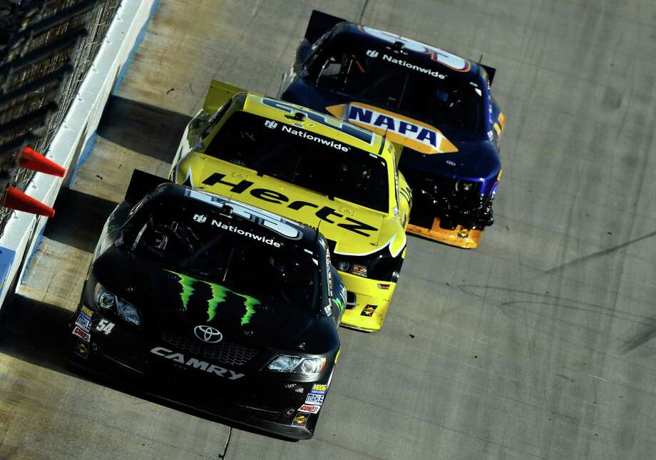 Kyle Busch (front), Joey Logano and Chase Elliott finished 1-2-3 at Saturday's Nationwide Series race at Dover. Busch earned his fifth Nationwide victory of the year. Photo: Jared C. Tilton / Getty Images / 2014 Getty Images