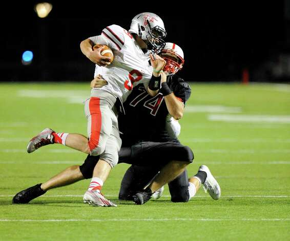Rensselaer's Thomas Bennett (74) sacks Worcester quarterback Dan Eckler (9) during the first half of an NCCA football game on Saturday, Sept. 27, 2014, in Troy, N.Y. (Hans Pennink / Special to the Times Union) ORG XMIT: HP102 Photo: Hans Pennink / Hans Pennink