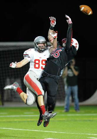 Rensselaer's Connor Young (46) breaks up a pass intended for Worcester's Brandon Eccher (89) during the first half of an NCCA football game on Saturday, Sept. 27, 2014, in Troy, N.Y. (Hans Pennink / Special to the Times Union) ORG XMIT: HP105 Photo: Hans Pennink / Hans Pennink