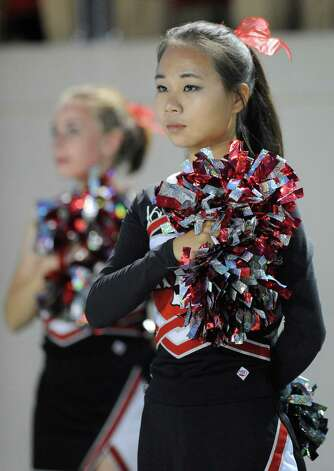 A Rensselaer cheerleader is seen as Rensselaer plays against Worcester during the first half of an NCCA football game on Saturday, Sept. 27, 2014, in Troy, N.Y. (Hans Pennink / Special to the Times Union) ORG XMIT: HP110 Photo: Hans Pennink / Hans Pennink
