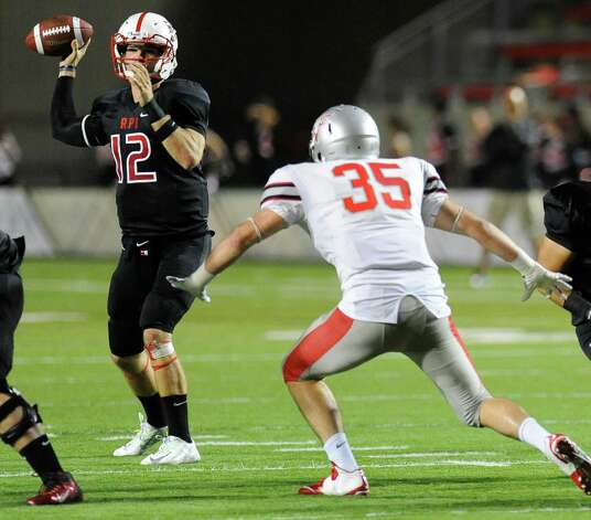 Rensselaer's Jeff Avery (12) throws a pass while being pressured by Worcester's Brian Murtagh (35) during the first half of an NCCA football game on Saturday, Sept. 27, 2014, in Troy, N.Y. (Hans Pennink / Special to the Times Union) ORG XMIT: HP111 Photo: Hans Pennink / Hans Pennink