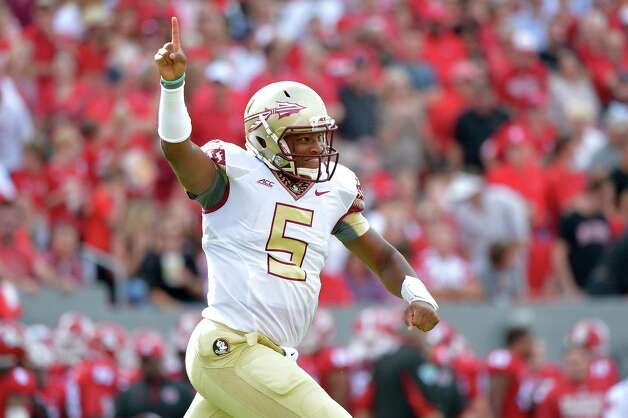 RALEIGH, NC - SEPTEMBER 27: Jameis Winston #5 of the Florida State Seminoles celebrates after throwing a first quarter touchdown pass during their game against the North Carolina State Wolfpack at Carter-Finley Stadium on September 27, 2014 in Raleigh, North Carolina. (Photo by Grant Halverson/Getty Images) ORG XMIT: 513036947 Photo: Grant Halverson / 2014 Getty Images