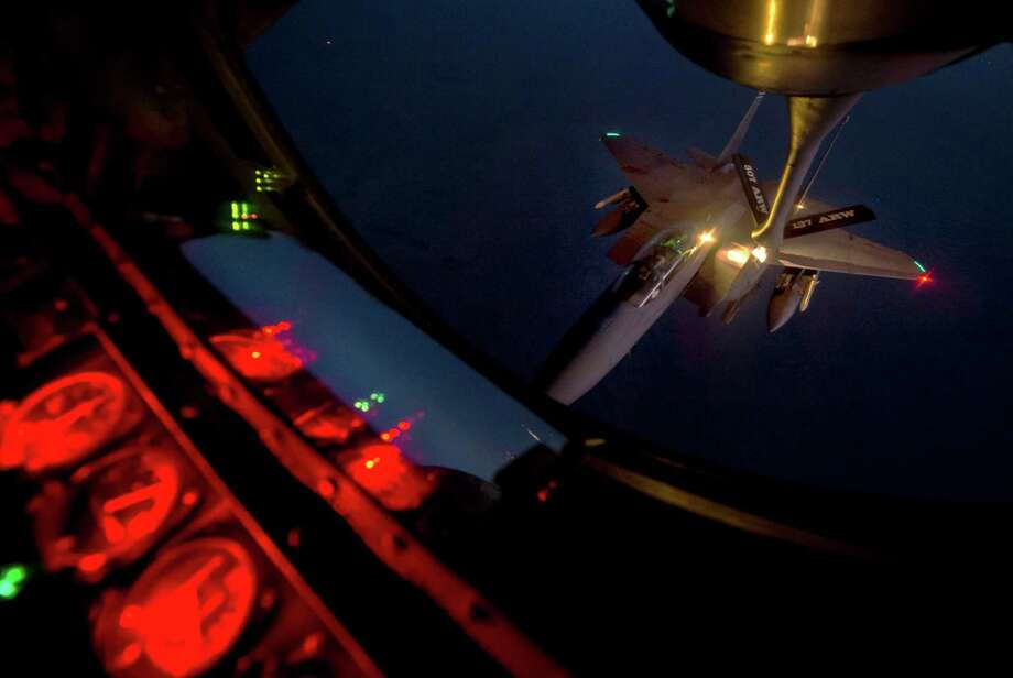 This photo provided by the U.S. Air Force shows an F-15 Strike Eagle receiving fuel from a KC-135 Stratotanker over northern Iraq after conducting airstrikes in Syria earlier this week. Photo: Associated Press / US Air Force