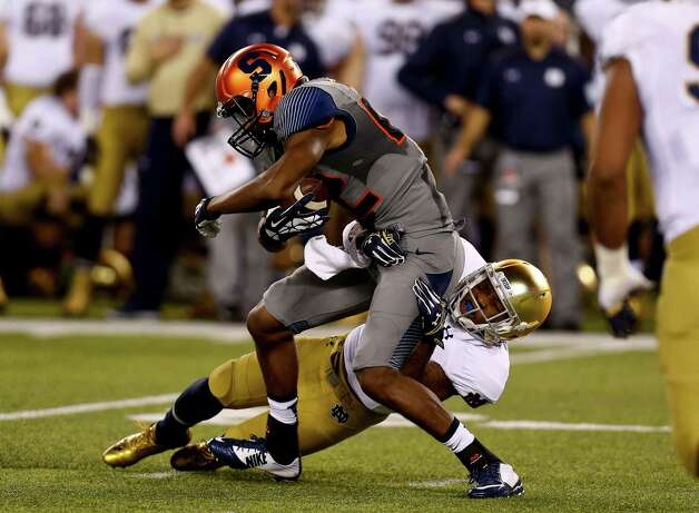 EAST RUTHERFORD, NJ - SEPTEMBER 27: Safety Elijah Shumate #22 of the Notre Dame Fighting Irish takes down wide receiver Adrian Flemming #22 of the Syracuse Orange during their game at MetLife Stadium September 27, 2014 in East Rutherford, New Jersey. (Photo by Jeff Zelevansky/Getty Images) ORG XMIT: 513053135 Photo: Jeff Zelevansky / 2014 Getty Images