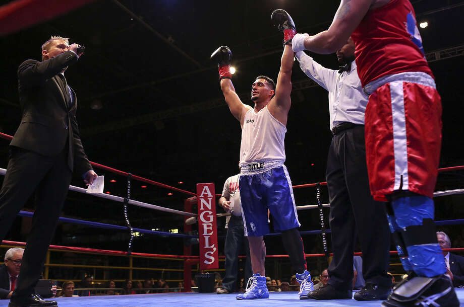 "Fransonet ""Jinji"" Martinez exults after beating Miguel Angel Lopez in an amateur boxing event at Cowboys Dancehall. Photo: Lisa Krantz / San Antonio Express-News / SAN ANTONIO EXPRESS-NEWS"