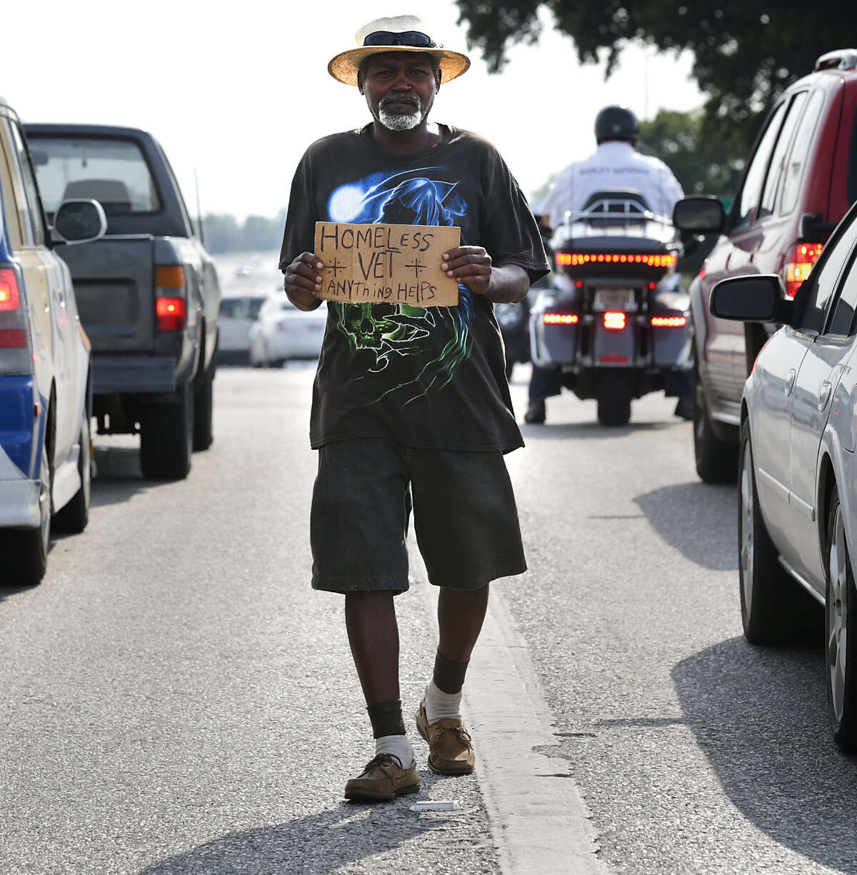 Earl Carrier, 61, who has been homeless for 15 years, panhandles at Loop 410 and Fredericksburg Road.