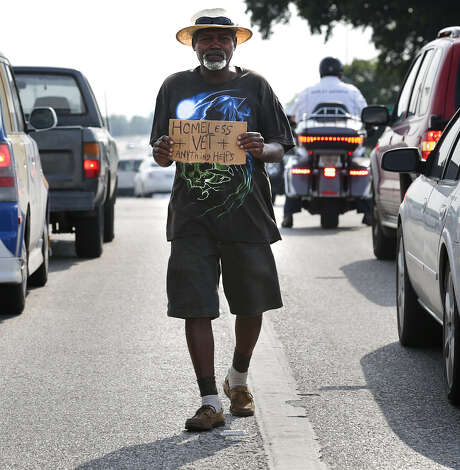 Earl Carrier, 61, who has been homeless for 15 years, panhandles at Loop 410 and Fredericksburg Road. Photo: Bob Owen / Express-News / © 2014 San Antonio Express-News