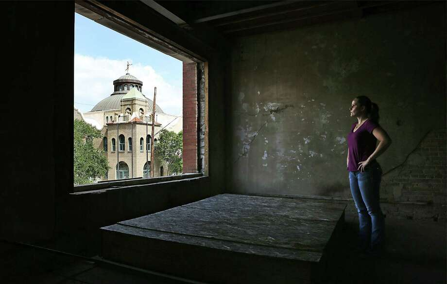 Randi Teaff, office manager for Hoover Construction Co., looks out an open window on the third floor of the company-owned Santa Monica Hotel building located in Cattleman Square on the near West Side. Photo: Photos By Bob Owen / San Antonio Express-News / © 2012 San Antonio Express-News