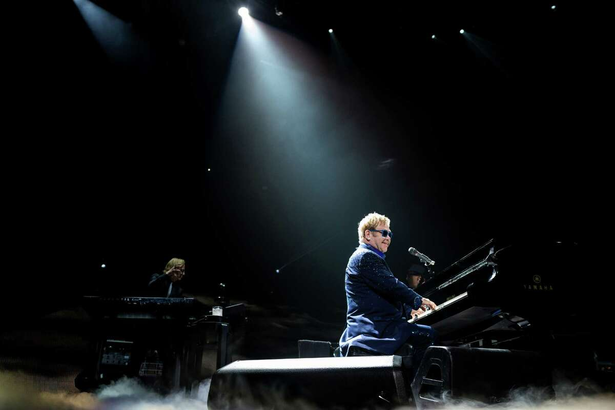 Legendary singer songwriter Elton John performs for thousands while on a stop of his current globe-trotting tour Saturday, Sept. 27, 2014, at KeyArena in Seattle, Washington.