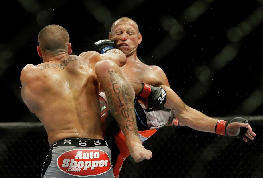 """Big-time mixed martial arts, the pinnacle to which the fighters of """"Thrown"""" aspire: In September, Eddie Alvarez hit Donald Cerrone in Las Vegas. (AP  Photo/John Locher) Photo: John Locher, Associated Press / AP"""