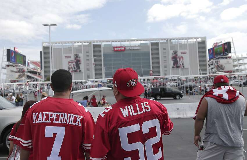 Fans walk outside of Levi's Stadium before an NFL football game between the San Francisco 49ers and the Philadelphia Eagles in Santa Clara.