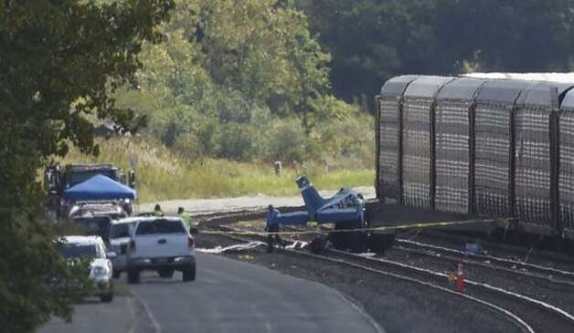 National Transportation Safety Board investigators comb through the wreckage of a fatal plane crash in Selkirk that occurred Sept. 8. Two people died in the crash at the CSX rail yard. (Skip Dickstein / Times Union) ORG XMIT: MER2014090912354745