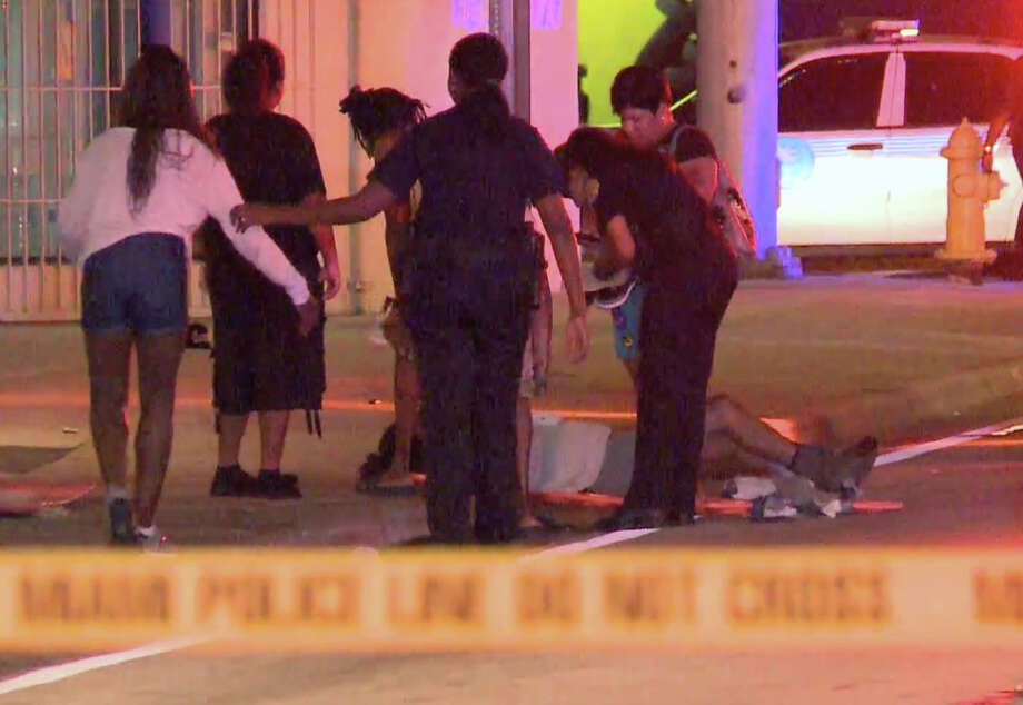 Emergency personnel help the wounded outside The Spot nightclub in Miami where 15 people were injured in a shooting, including five girls ages 11 to 17. Photo: Uncredited / Associated Press / APTN