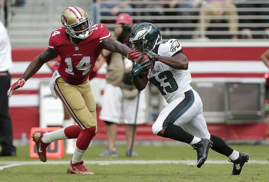 Philadelphia Eagles' Darren Sproles (43) runs past San Francisco 49ers' Kassim Osgood (14) to return a punt 82 yards for a touchdown during the second quarter of an NFL football game in Santa Clara, Calif., Sunday, Sept. 28, 2014. (AP Photo/Marcio Jose Sanchez) Photo: Marcio Jose Sanchez, Associated Press