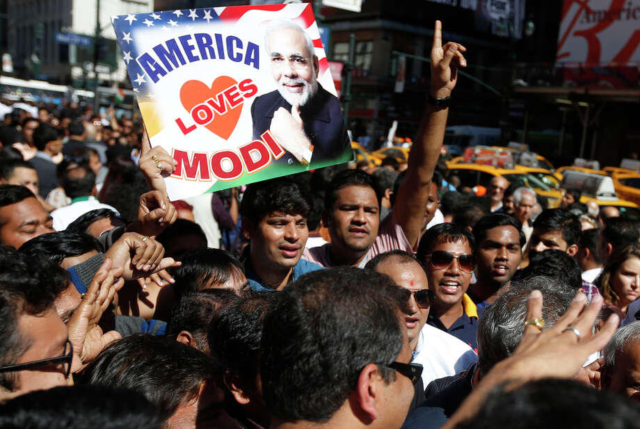 Supporters of Indian Prime Minister Narendra Modi fill the streets outside Madison Square Garden after he gave a speech during a reception by the Indian community in honor of his visit to the United States. Photo: Jason DeCrow / Associated Press / FR103966 AP