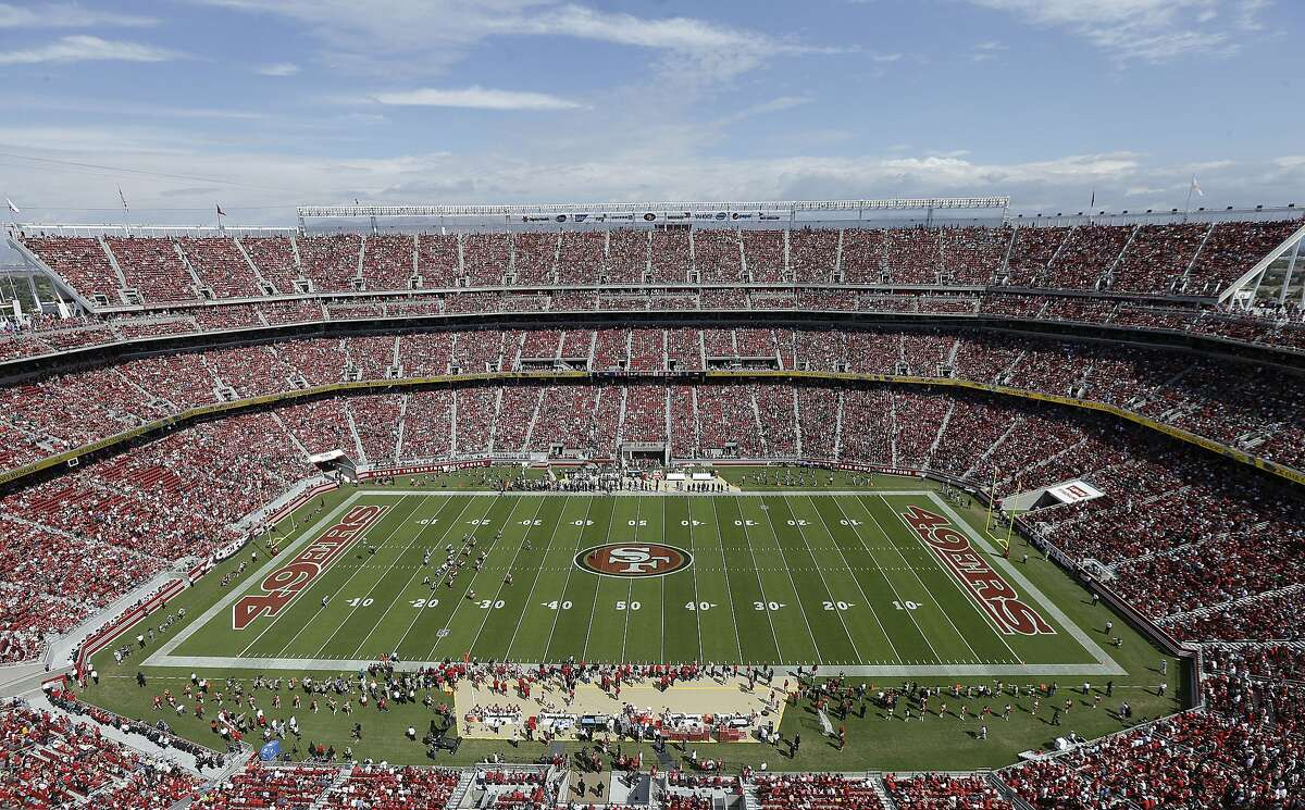 Fans at Levi's Stadium watch during the first quarter of an NFL football game between the San Francisco 49ers and the Philadelphia Eagles in Santa Clara, Calif., Sunday, Sept. 28, 2014.