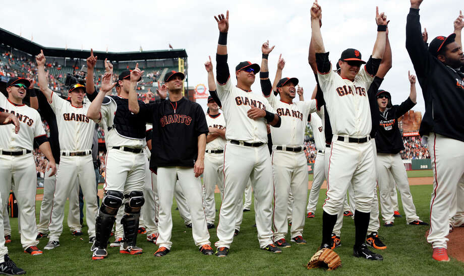The Giants and their fans celebrate Sunday's 9-3 victory over the Padres in the regular-season finale at AT&T Park. To return this season, the Giants must win Wednesday at Pittsburgh. Photo: Scott Strazzante / The Chronicle / ONLINE_YES