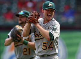 ARLINGTON, TX - SEPTEMBER 28: Sonny Gray #54 of the Oakland Athletics celebrates after defeating the Texas Rangers 4-0 and advancing to the MLB playoffs at Globe Life Park in Arlington on September 28, 2014 in Arlington, Texas. (Photo by Ronald Martinez/Getty Images)