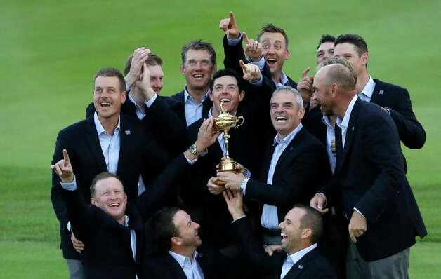 Europe team captain Paul McGinley, center right, and his team  hold the trophy after winning the 2014 Ryder Cup golf tournament at Gleneagles, Scotland, Sunday, Sept. 28, 2014. (AP Photo/Matt Dunham) ORG XMIT: RCUP327 Photo: Matt Dunham / AP